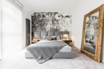 Bedroom with large wooden mirror Wall mural