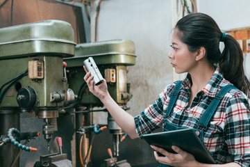 milling machining girl holding digital tablet