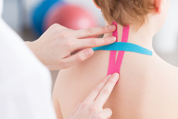 Physiotherapist uses resistance tapes