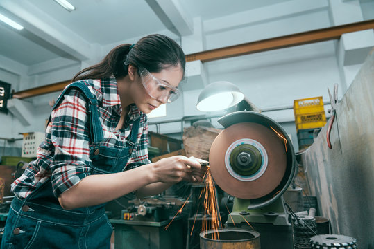 milling machining worker using abrasive wheel tool