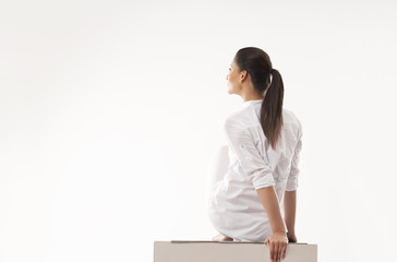 Woman practicing yoga over white background