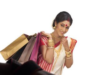 Bengali woman holding shopping bags
