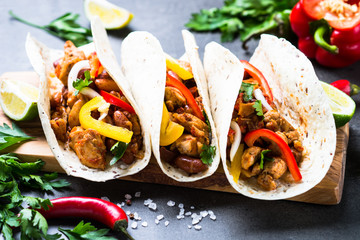 Mexican taco with meat beans and vegetables.