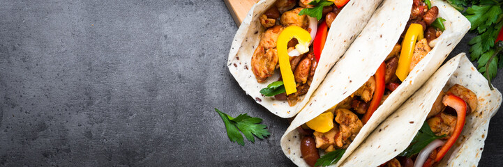 Mexican taco with meat beans and vegetables. Long banner format.