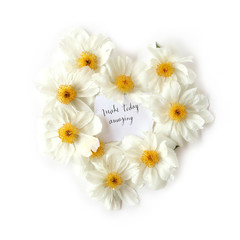 Flat lay view of paper with english quote Make today amazing. Inspiration words with a floral heart-shaped frame made of white peony flowers. Top view.