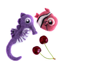 Pink fish and purple sea horse handmade wool and cherries Isolate on white background