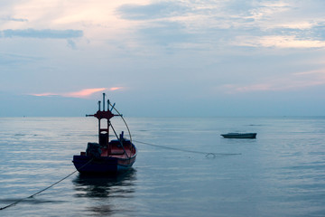 Morning light with fishing boat