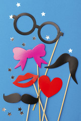 Party background with funny props on a blue background. Wedding party photobooth.