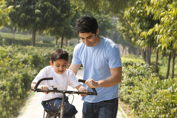 Father and son with a bicycle