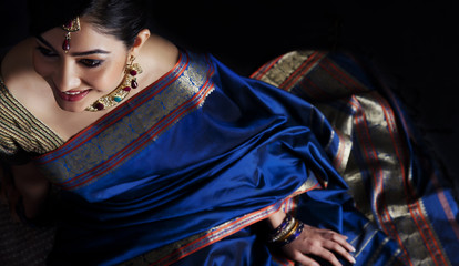 Woman in a blue saree