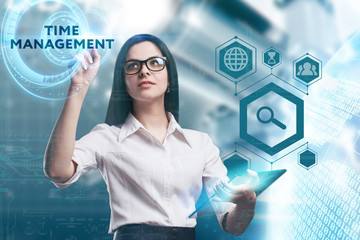 The concept of business, technology, the Internet and the network. A young entrepreneur working on a virtual screen of the future and sees the inscription: Time management