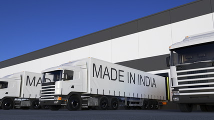 Freight semi trucks with MADE IN INDIA caption on the trailer loading or unloading. Road cargo transportation 3D rendering