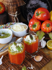 Tomato soup with pesto sauce and bryndza cheese in a glass. Village style