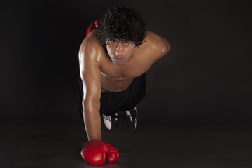 Portrait of boxer doing push ups