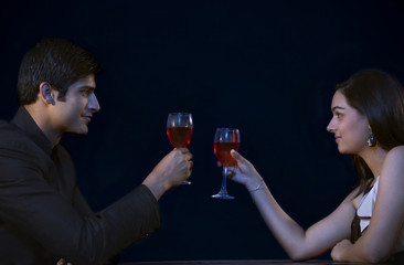 Romantic young couple toasting on date