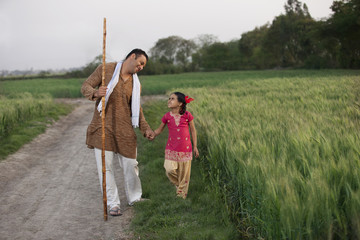 Little girl taking a walk with her father