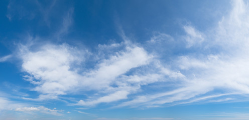 Panoramic blue sky background with white clouds on a sunny day Wall mural