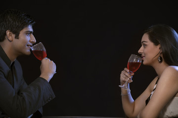 Young couple enjoying red wine on romantic date