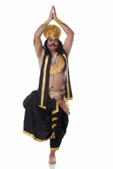 Man dressed as Raavan in yoga pose