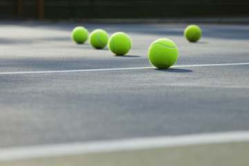 Close-up of tennis balls lying on ground