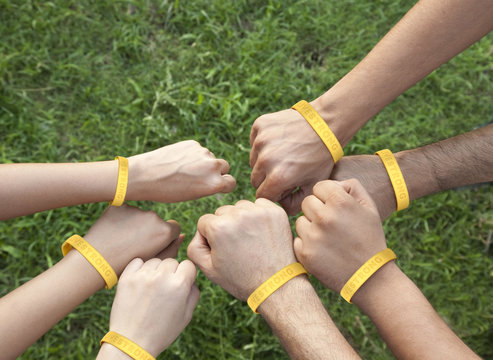 Hands with wristbands
