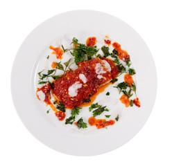 fish under tomato-pepper sauce