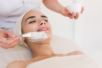 Spa facial mask application. Spa beauty organic facial mask application at day spa salon. Beauty treatment in spa salon.