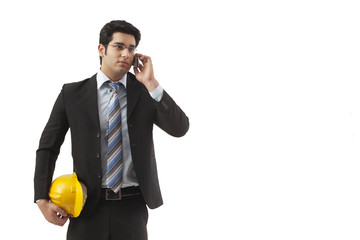 Construction worker having conversation on mobile phone