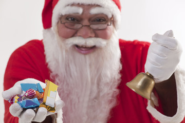 Close-up of Santa Claus offering sweets