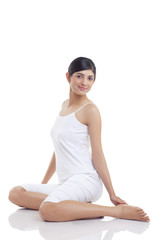 Full length of young woman against white background