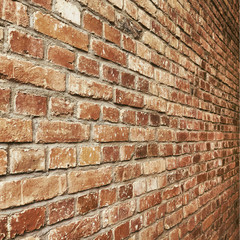 Old vintage brick wall perspective texture for square background