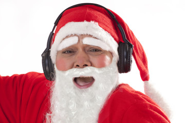 Close up portrait of Santa Claus listening to music over white background