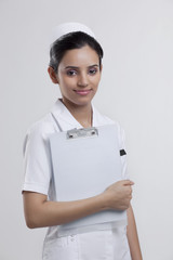 Portrait of a nurse with a clipboard