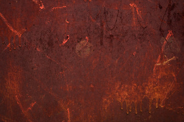 Old rusty red wall of abandoned house