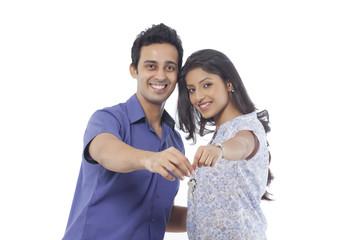 Portrait of a couple holding house keys