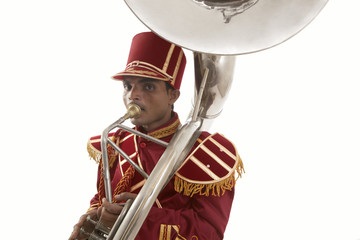 Portrait of a bandmaster playing a sousaphone