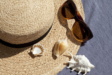Summer vacationsl concept with straw hat, sunglasses and seashells