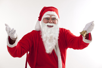 Happy Santa Claus greeting with bell over white background
