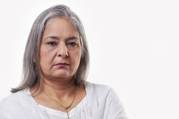Portrait of a mature woman over white background