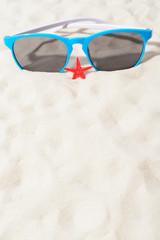 Sunglasses and small sea star
