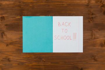 Back to school message written on open notebook