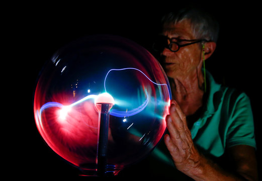 Beams of coloured light are seen in a plasma globe at the EBM Elektrizitaetsmuseum museum in Muenchenstein