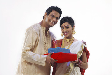 Portrait of a Bengali couple with gifts