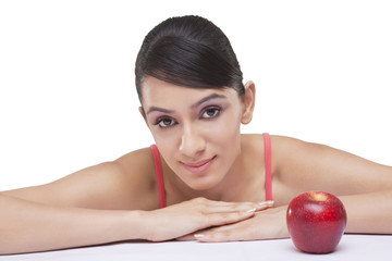 Portrait of beautiful woman with fresh apple over white background