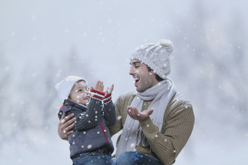 Happy father and son enjoying winter