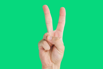 "Fingers shaped in ""V"" letter showing victory sign."