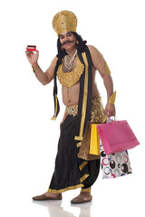 Man dressed as Raavan with credit card and shopping bags