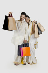 South Indian couple with shopping bags