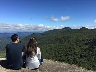 Couple at the top of  a mountain in  Monte Verde, Minas Gerais, Brazil.
