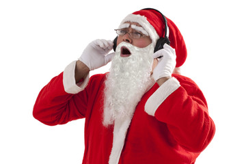 Santa Claus enjoying music from headset over white background